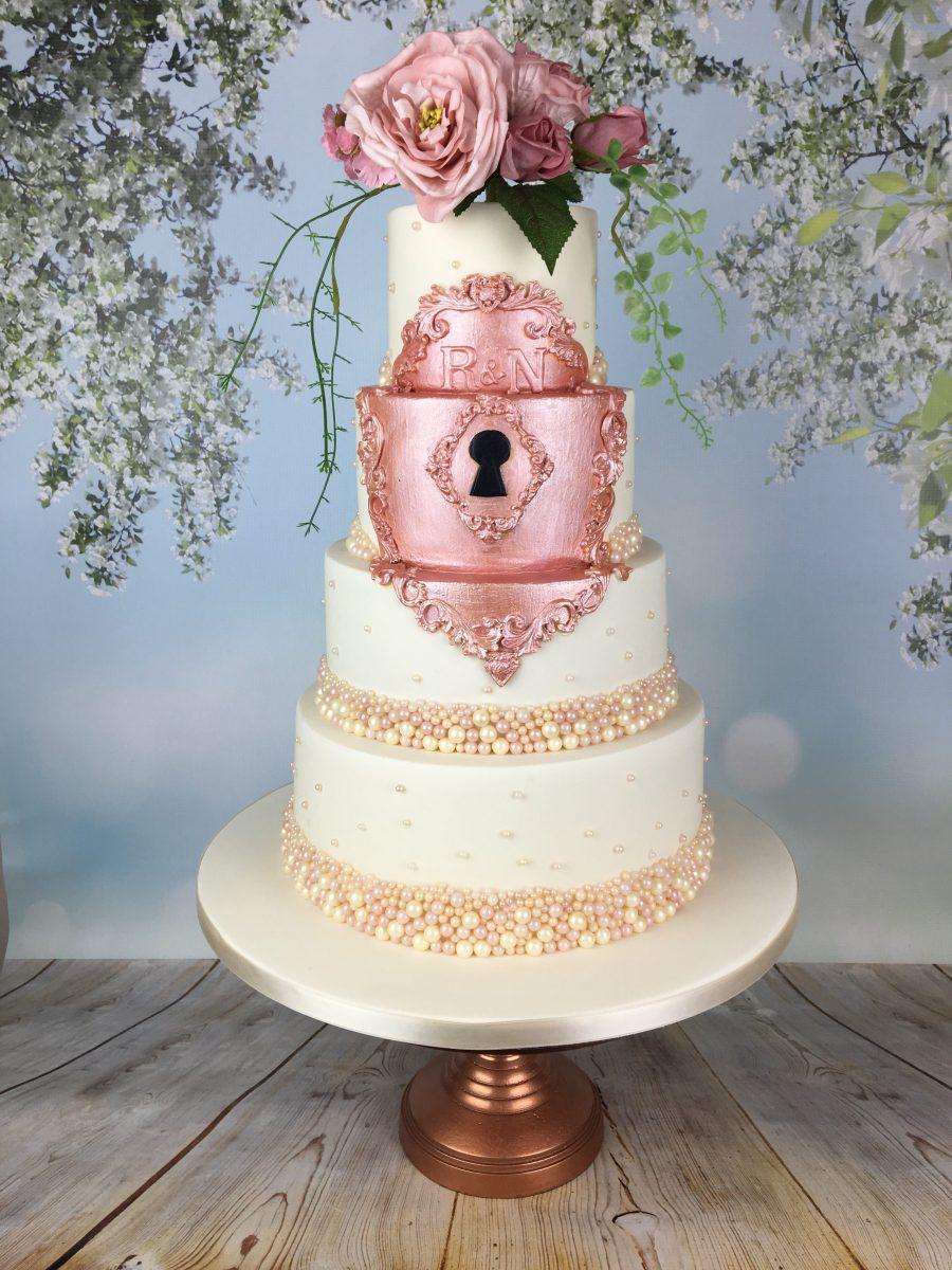 fairytale rose gold lock wedding cake