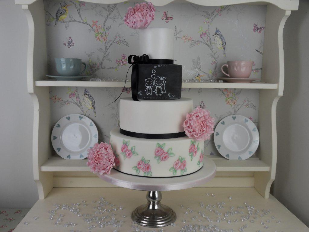 Pink painted roses wedding cake