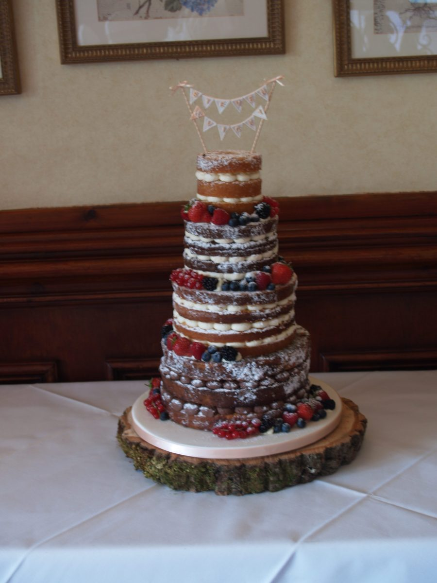 naked wedding cake with bunting topper mel 39 s amazing cakes. Black Bedroom Furniture Sets. Home Design Ideas